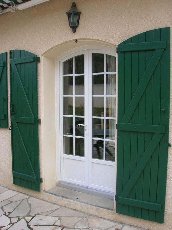 Porte fenêtre PVC cintrée